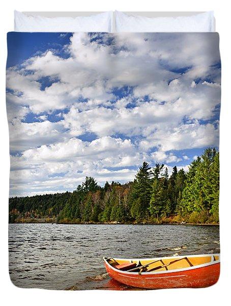 Red Canoe On Lake Shore Duvet Cover by Elena Elisseeva