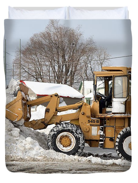 Removing Snow Duvet Cover by Ted Kinsman