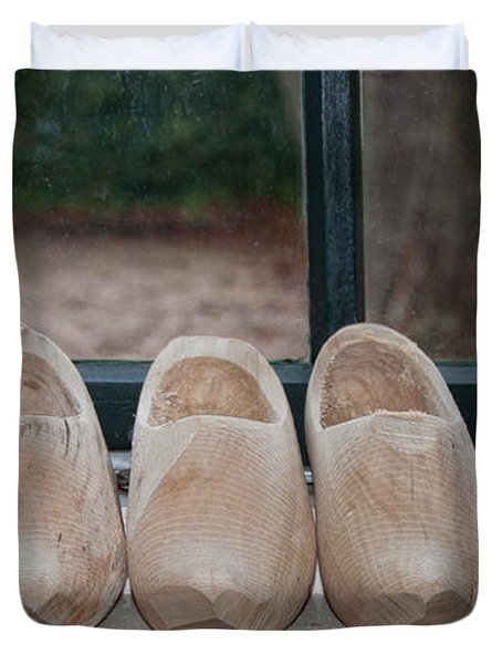 Duvet Cover featuring the digital art Rows Of Wooden Shoes by Carol Ailles
