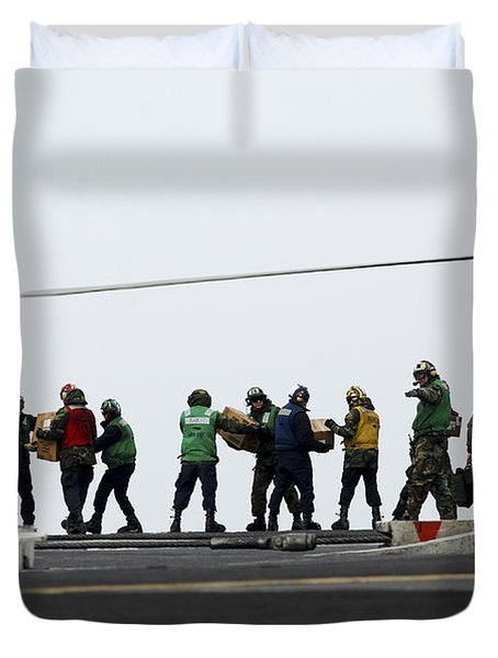 Sailors And Marines Load Supplies Onto Duvet Cover by Stocktrek Images