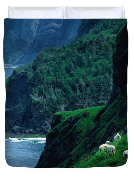 Sheep Graze Along The Steep Banks Duvet Cover