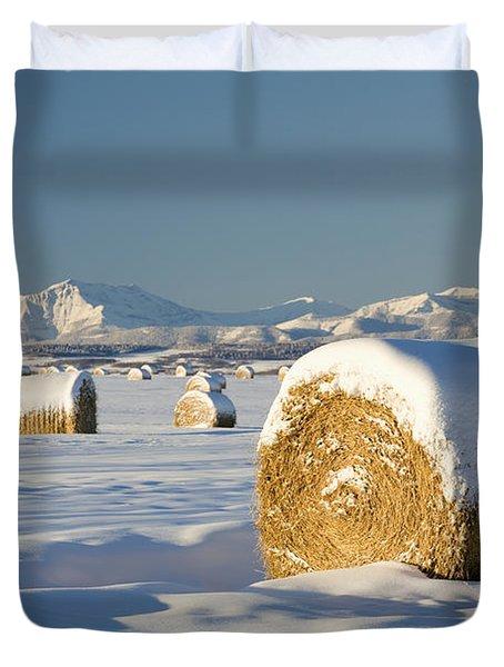 Snow-covered Hay Bales Okotoks Duvet Cover by Michael Interisano