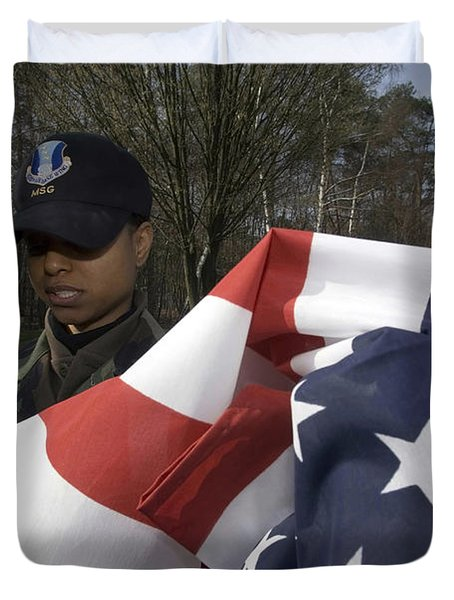 Soldier Unfurls A New Flag For Posting Duvet Cover by Stocktrek Images