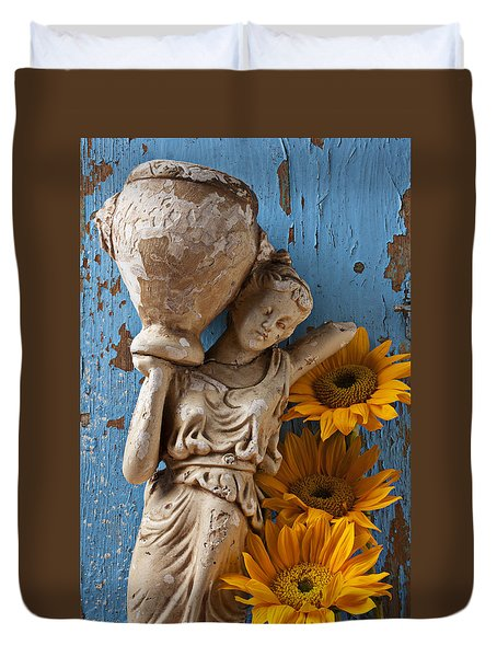Statue Of Woman With Sunflowers Duvet Cover by Garry Gay