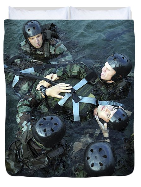 Students Secure A Simulated Casualty Duvet Cover by Stocktrek Images