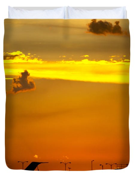 Sunset At Kci Duvet Cover by Lisa Plymell