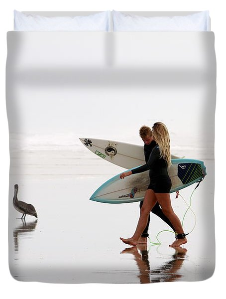 Duvet Cover featuring the photograph Surfers And A Pelican by Alice Gipson