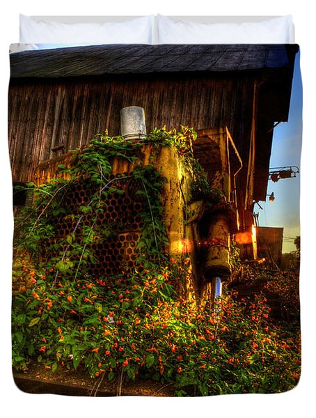 Tactor Overgrown With Flowers And Weeds At Sunset Duvet Cover by Dan Friend