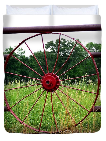Duvet Cover featuring the photograph Texas Wildflowers Through Wagon Wheel by Kathy  White