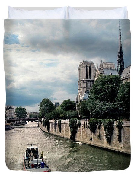 Duvet Cover featuring the photograph Tour Boat Passing Notre Dame by Dave Mills
