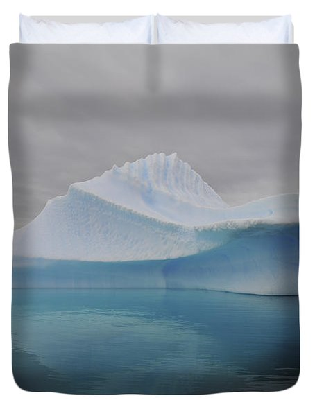 Translucent Blue Iceberg Reflection Duvet Cover by Mathieu Meur