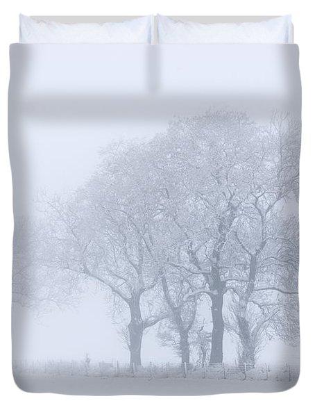 Trees Seen Through Winter Whiteout Duvet Cover by John Short
