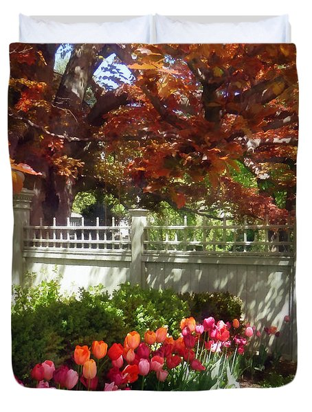 Tulips By Dappled Fence Duvet Cover by Susan Savad