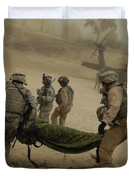 U.s. Army Soldiers Medically Evacuate Duvet Cover by Stocktrek Images