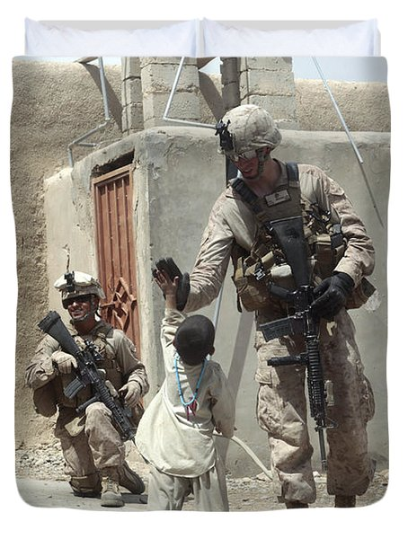 U.s. Marine Gives An Afghan Child Duvet Cover by Stocktrek Images