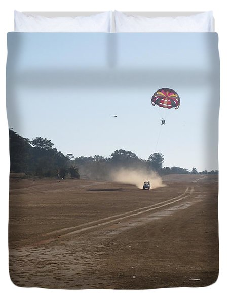 Vehicle Pulling A Couple Doing Tandem Parasailing Duvet Cover by Ashish Agarwal