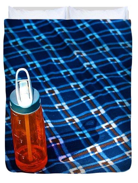 Water Bottle On A Blanket Duvet Cover by Eric Tressler