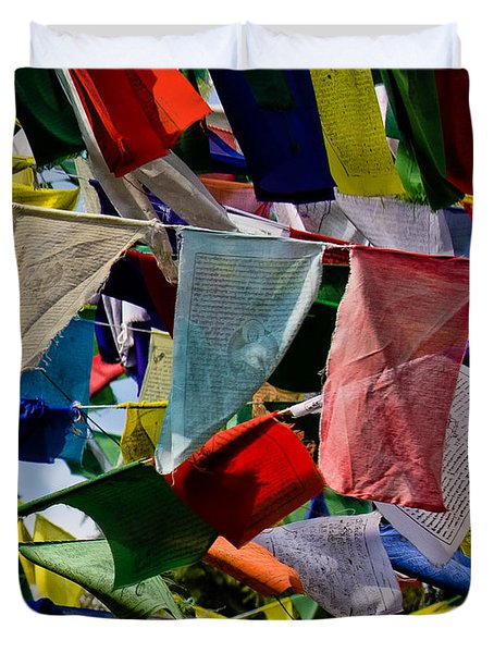 Duvet Cover featuring the photograph Waving Prayer Flags by Don Schwartz