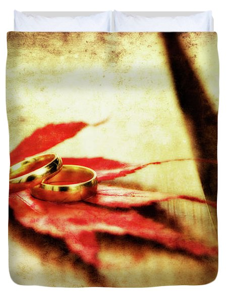 Wedding Rings On Red Duvet Cover by Meirion Matthias