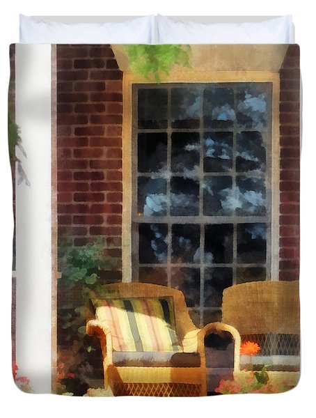 Wicker Chair With Striped Pillow Duvet Cover by Susan Savad