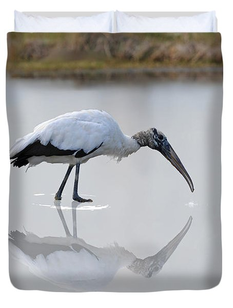 Duvet Cover featuring the photograph Wood Stork Eating by Dan Friend