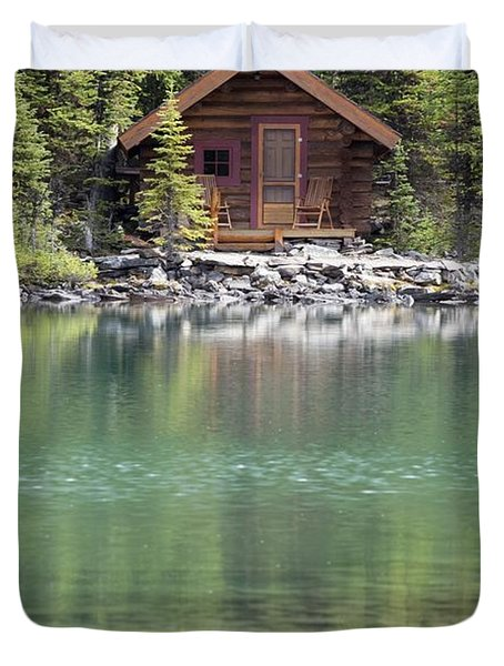 Wooden Cabin Along A Lake Shore Duvet Cover by Michael Interisano