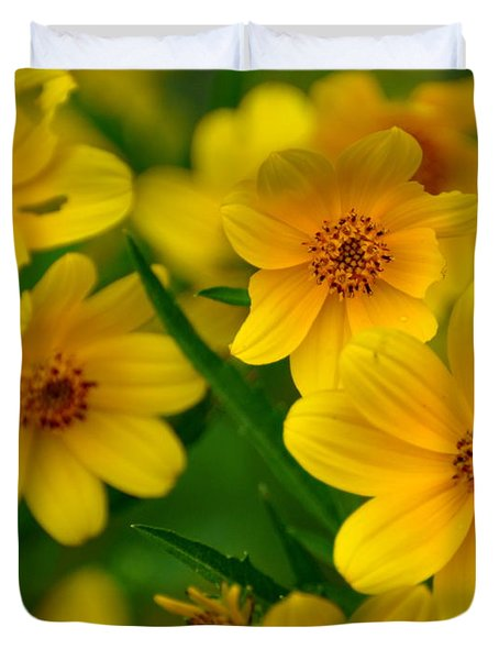 Duvet Cover featuring the photograph Yellow Flowers by Marty Koch