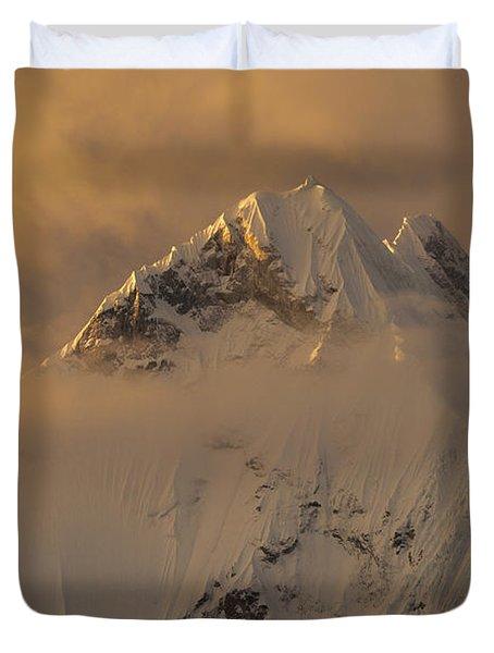 Yerupaja Summit Ridge 6617m At Sunset Duvet Cover by Colin Monteath