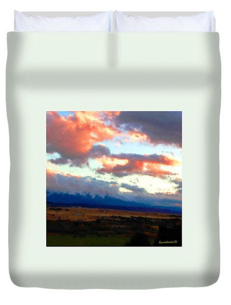 Sunset Clouds Over Spanish Peaks Duvet Cover by Anastasia Savage Ealy
