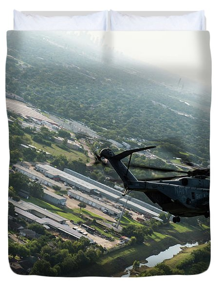 An Mh-53e Sea Dragon Helicopter Flies Over Flooded Areas Of Houston, Texas. Duvet Cover