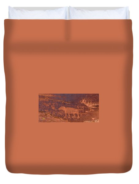 Duvet Cover featuring the photograph Ancient Native American Petroglyphs On A Canyon Wall Near Moab. by Jim Thompson