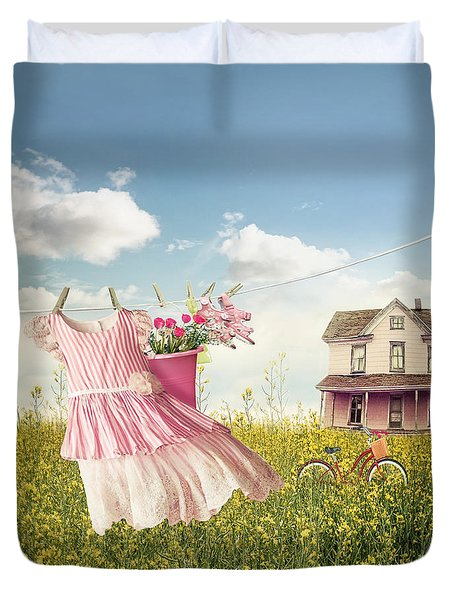Child's Dress And Toys Hanging On Line With Farmhouse In Backgro Duvet Cover by Sandra Cunningham