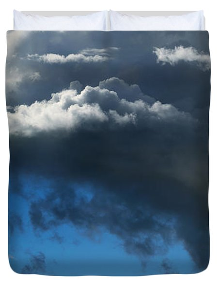 Cows Grazing Under Dramatic Clouds Duvet Cover by Wernher Krutein