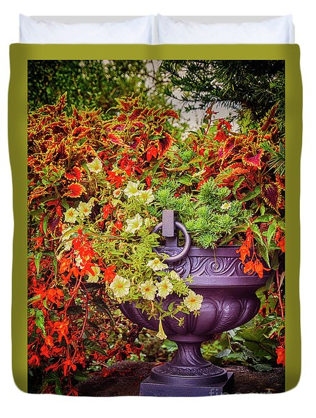 Duvet Cover featuring the photograph Decorative Flower Vase In Garden by Ariadna De Raadt