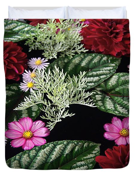 Duvet Cover featuring the photograph Floating Flower Bouquet by Byron Varvarigos