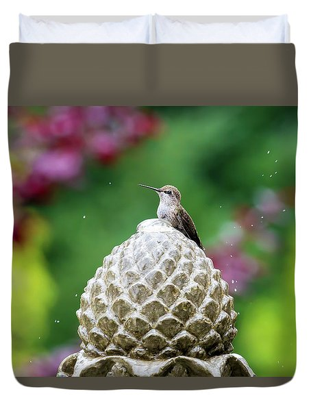 Hummingbird On Garden Water Fountain Duvet Cover by David Gn