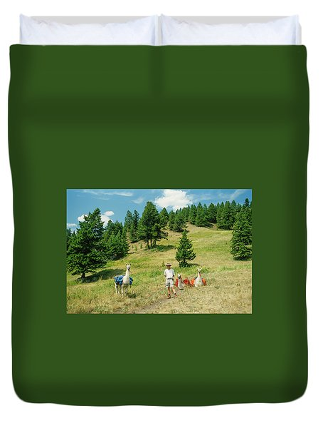 Man Posing With Llamas In A Beautiful Grassy Meadow Duvet Cover by Jerry Voss