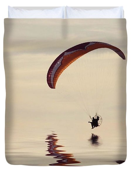 Powered Paraglider Duvet Cover by John Edwards