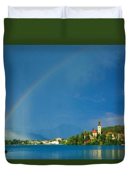 Duvet Cover featuring the photograph Rainbow Over Lake Bled by Ian Middleton