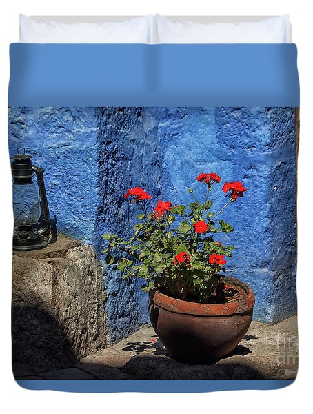 Duvet Cover featuring the photograph Red Geranium Near A Blue Wall by Patricia Hofmeester
