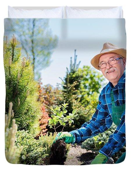 Senior Gardener Digging In A Garden. Duvet Cover