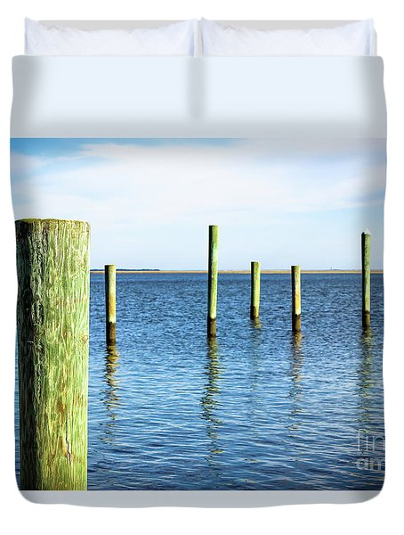 Duvet Cover featuring the photograph Wood Pilings by Colleen Kammerer