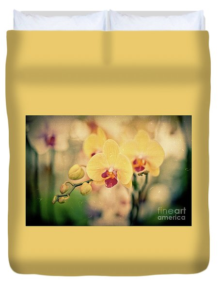 Duvet Cover featuring the photograph Yellow Orchids by Ana V Ramirez