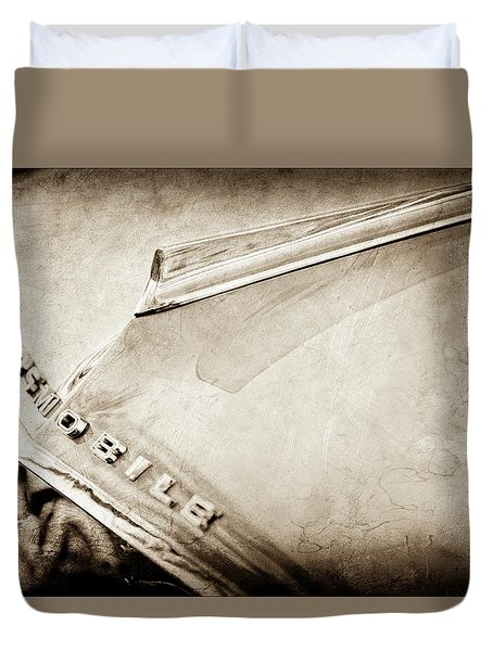 Duvet Cover featuring the photograph 1962 Oldsmobile Hood Ornament And Emblem -0598s by Jill Reger
