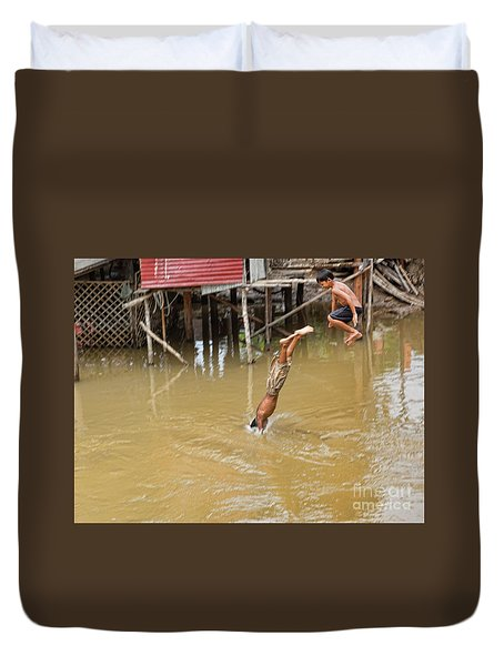 2 Cambodian Boys Dive Color Duvet Cover by Chuck Kuhn