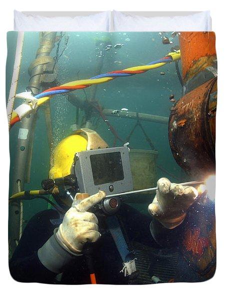 U.s. Navy Diver Welds A Repair Patch Duvet Cover by Stocktrek Images