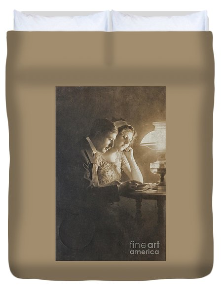 Vintage Loving Couple Reading With Oil Lamp Duvet Cover