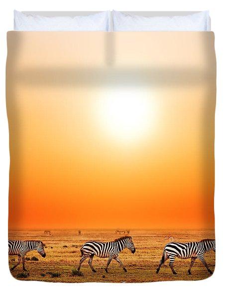 Zebras Herd On African Savanna At Sunset. Duvet Cover