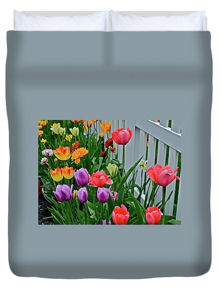 Duvet Cover featuring the photograph 2018 Acewood Tulips Against The White Fence 2 by Janis Nussbaum Senungetuk