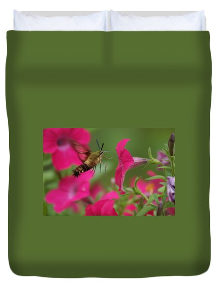 Duvet Cover featuring the photograph Hummer Moth by Heidi Poulin